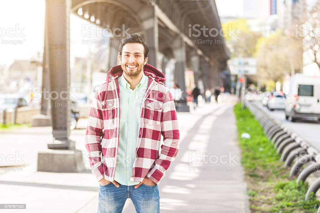 Portrait of an handsome young man in Hamburg stock photo