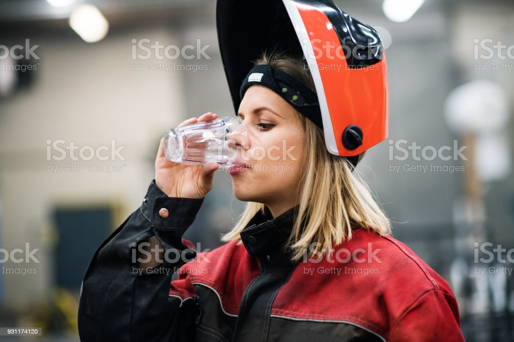 Portrait of an industrial woman worker at the factory.