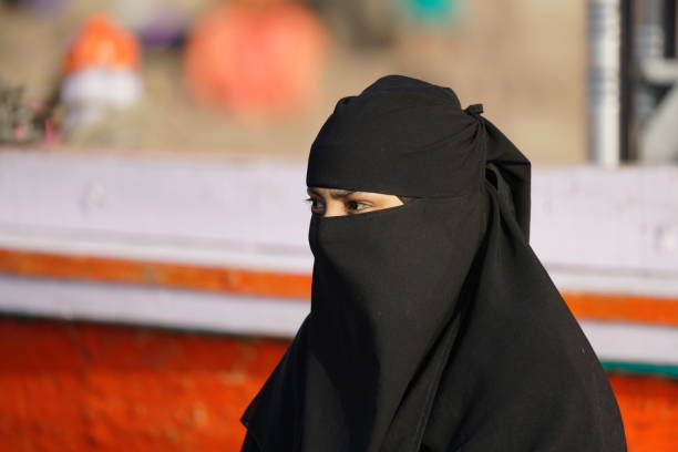 Portrait of an Islam lady in town of Varanasi Varanasi, Uttar Pradesh, India - 24 March 2019: Portrait of an Islam lady. religious veil stock pictures, royalty-free photos & images