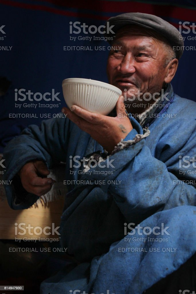 Portrait of an old man drinking airag in a yurt in the Mongolian steppe stock photo