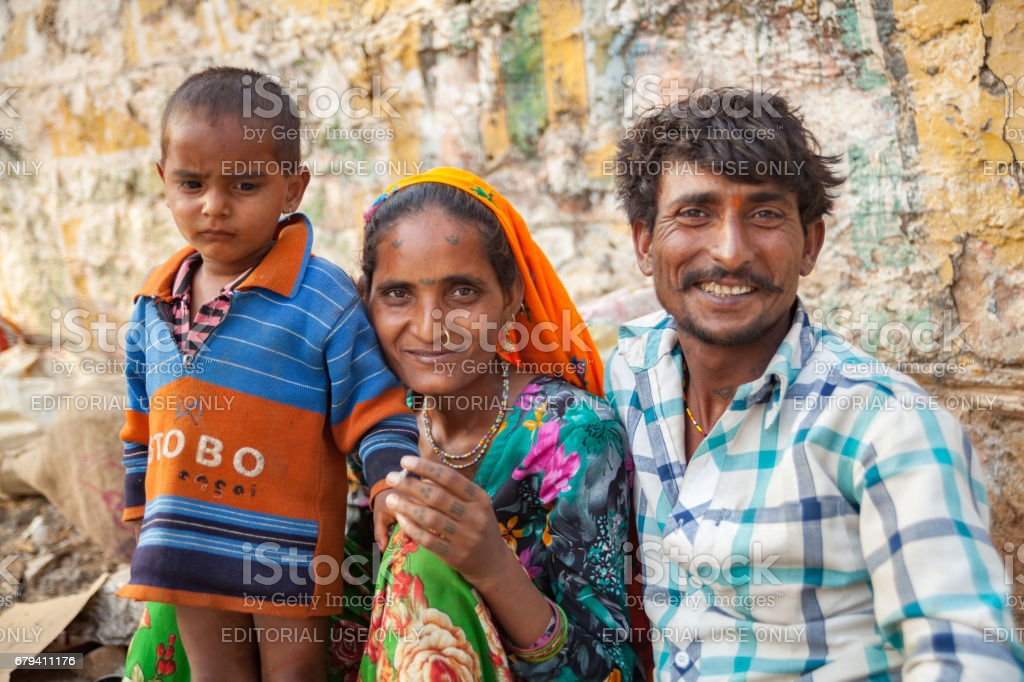 Portrait of an unidentified Indian all smiling Gypsy family at Chaksu fair in Jaipur royalty-free stock photo