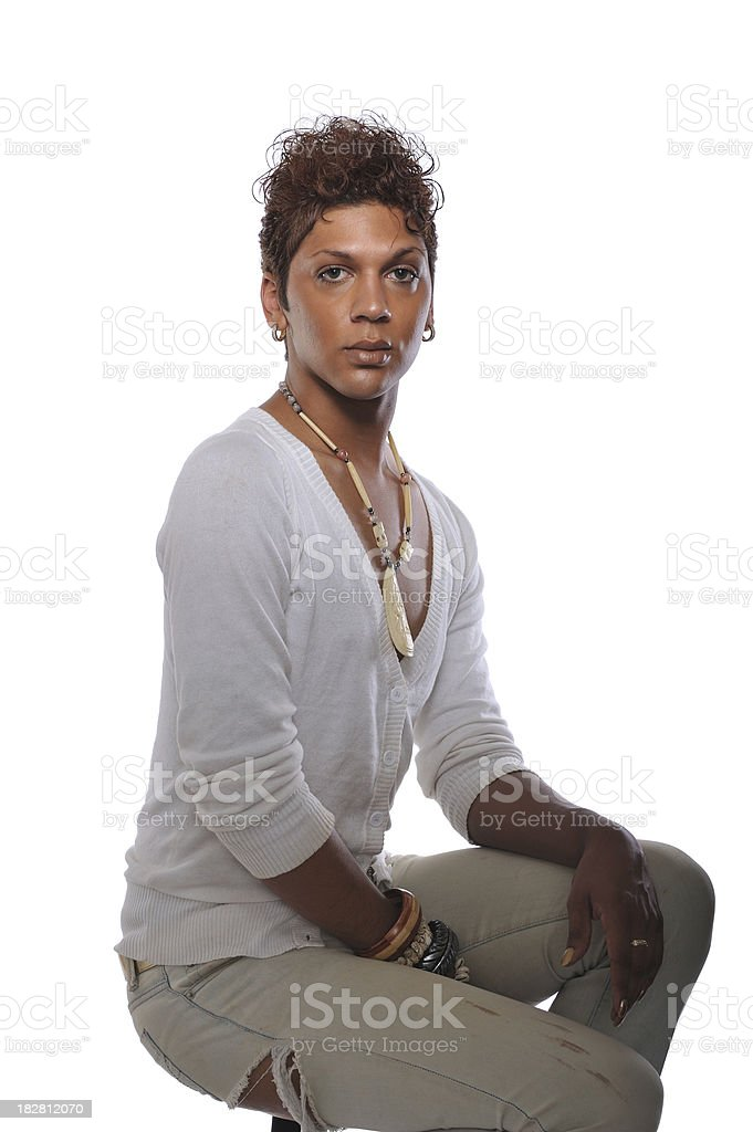 Portrait of androgynous man sitting stock photo