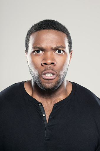 Portrait Of Angry Afro American Young Man Stock Photo - Download Image Now