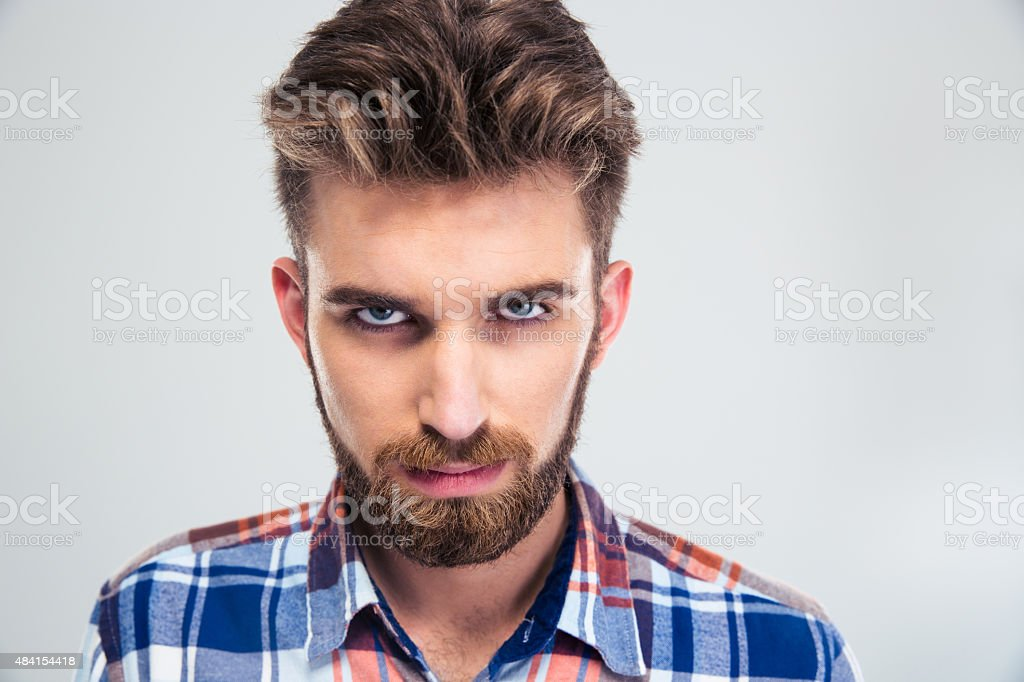 Portrait of angry man looking at camera stock photo