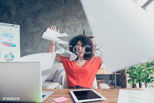 187928332 istock photo Portrait of angry violent financier in casual outfit throwing away documents yelling cruelly tired from routine sitting at desk. Education study university concept 979006376
