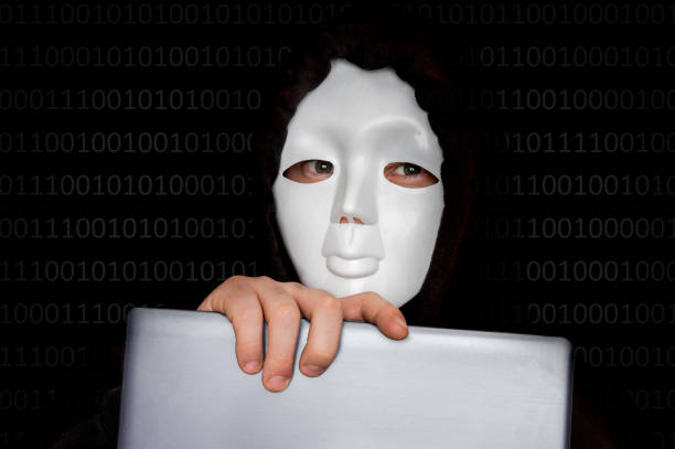 Portrait of anonymous man with white mask isolated on black Portrait of anonymous man with white mask isolated on black background anonymous activist network stock pictures, royalty-free photos & images