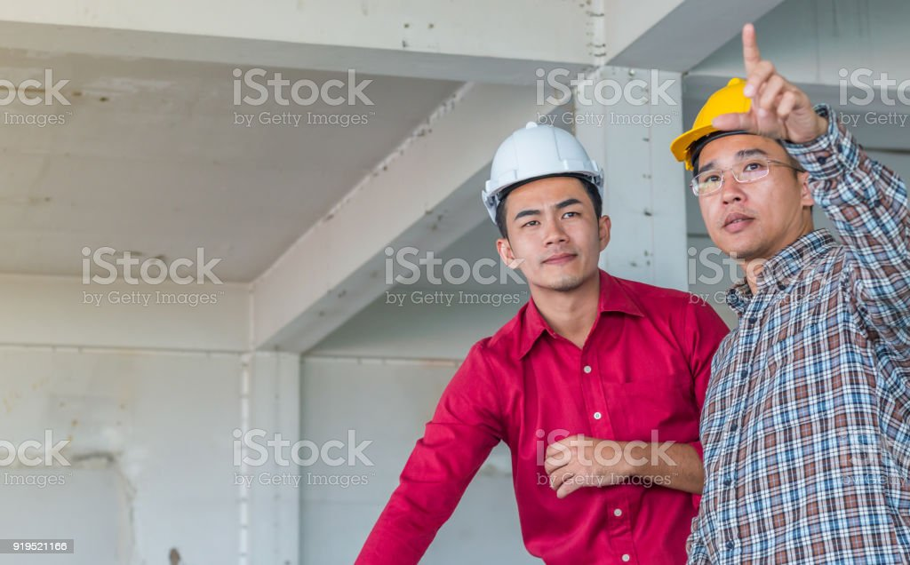 Portrait of arabian engineer talking about construction job and portrait of arabian engineer talking about construction job and verify the blueprint with commitment to success malvernweather Image collections