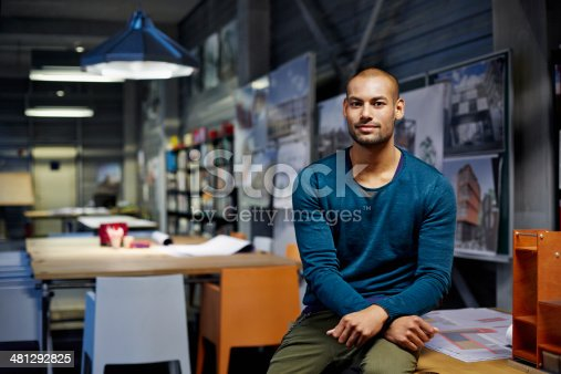 Portrait of male architect at workstation in modern studio