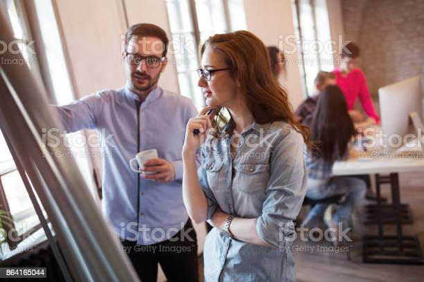 Portrait Of Architects Discussing And Drawing On Board Stock Photo - Download Image Now