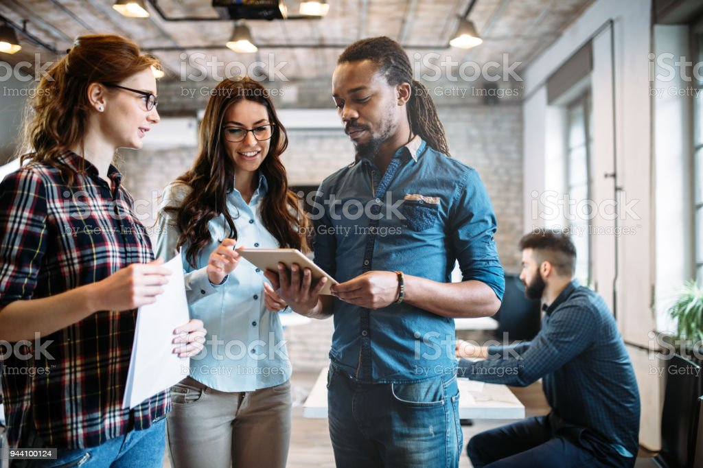 Portrait of architects having discussion in office stock photo