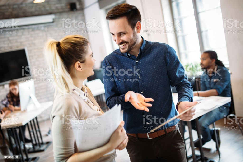 Portrait of architects having discussion in office royalty-free stock photo