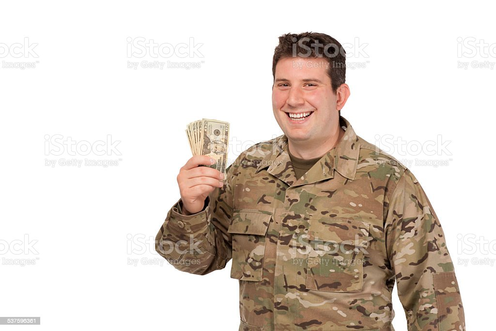 Portrait of army soldier with dollars stock photo