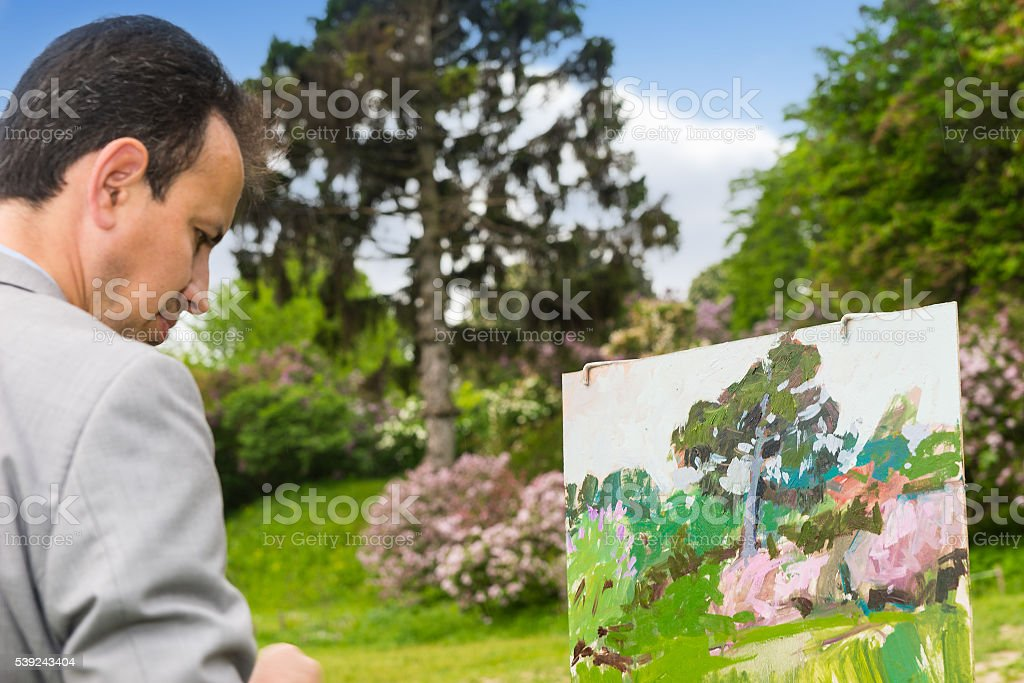Portrait of artist working outdoors in the park or garden royalty-free stock photo