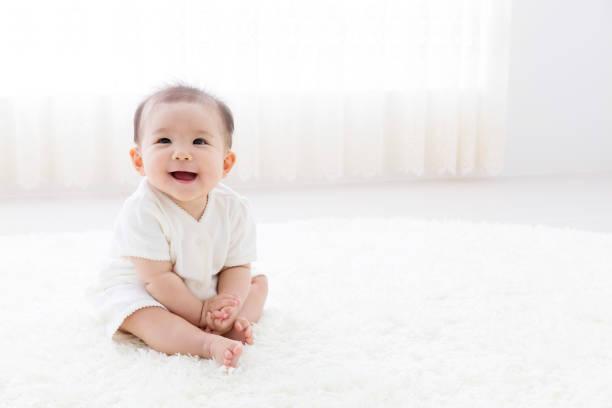 portrait of asian baby in living room - asia orientale foto e immagini stock