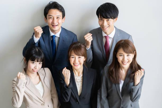 アジアビジネスグループのポートレートスタンディング - よそいきの服 ストックフォトと画像