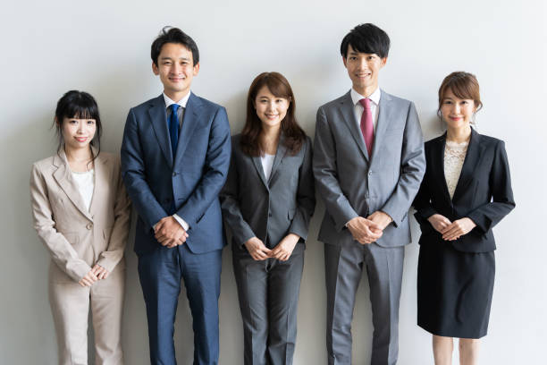 portrait of asian business group standing portrait of asian business group standing japanese ethnicity stock pictures, royalty-free photos & images