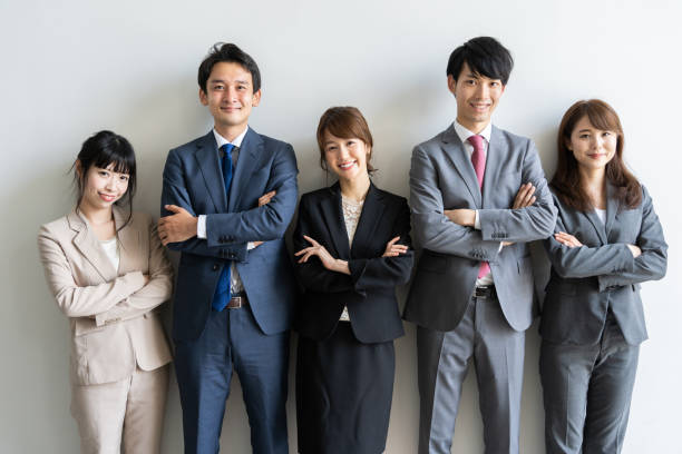 portrait of asian business group standing - asia orientale foto e immagini stock