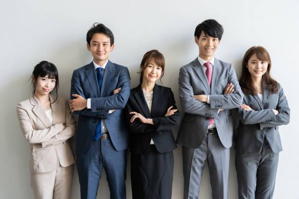 アジアビジネスグループのポートレートスタンディング - 部下 ストックフォトと画像