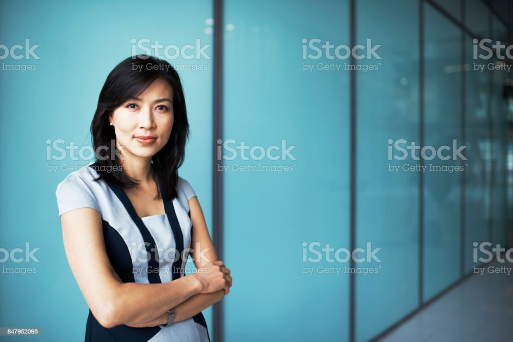 Portrait of asian business woman in corporate office stock photo