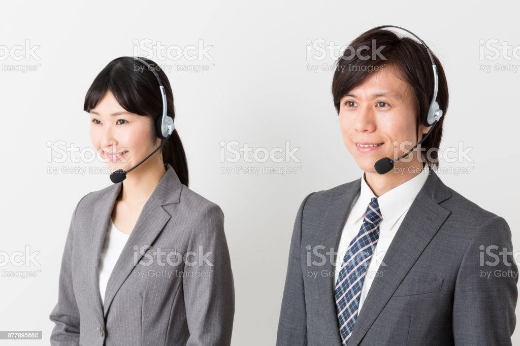 portrait of asian businessgroup using headset stock photo