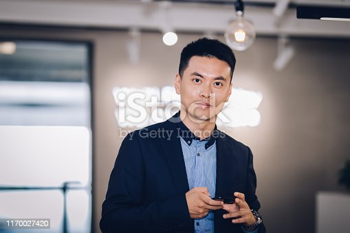 960195072 istock photo Portrait of Asian businessman at office 1170027420