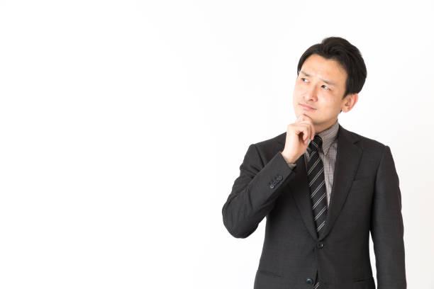 アジア系のビジネスマンが白い背景で隔離の肖像画 - 悩む ストックフォトと画像