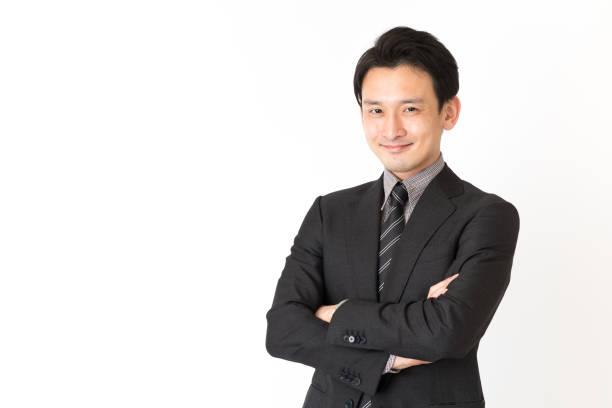 アジア系のビジネスマンが白い背景で隔離の肖像画 - 男性のみ ストックフォトと画像