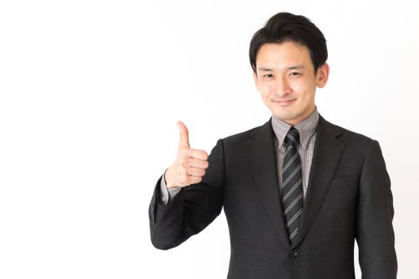 アジア系のビジネスマンが白い背景で隔離の肖像画 - 親指 ストックフォトと画像