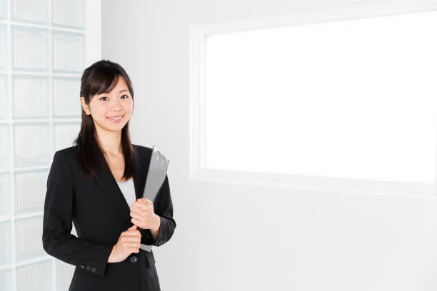 portrait of asian businesswoman in office stock photo
