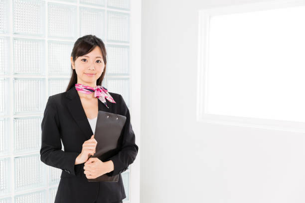 アジアのビジネスウーマンの肖像画のオフィス - 受付係 ストックフォトと画像
