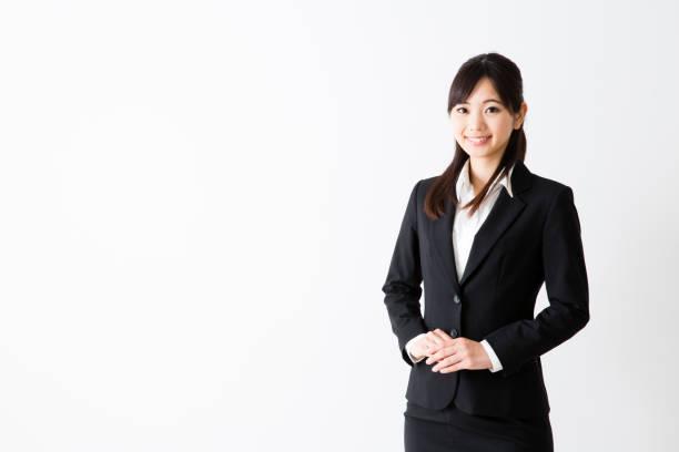 アジアのビジネスウーマンの肖像画の分離に白背景 - 受付係 ストックフォトと画像