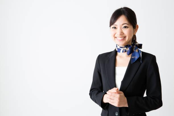 wthie の背景に分離されたアジアの実業家の肖像画 - フライトアテンダント ストックフォトと画像