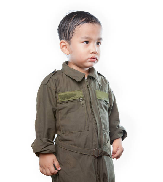 portrait of asian children wearing airforce pilot suit isolated white background portrait of asian children wearing airforce pilot suit isolated white background flight suit stock pictures, royalty-free photos & images