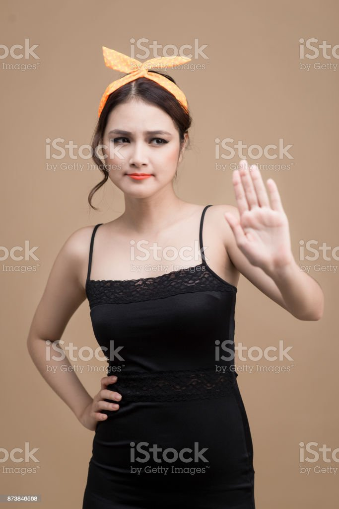 Portrait of asian girl with pretty smile in pinup style with hands gesture on yellow background stock photo