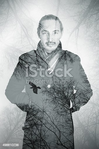 istock Portrait of Asian man combined with bare trees 498810236