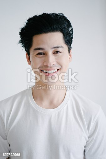istock Portrait of asian man smiling, white background 655752966