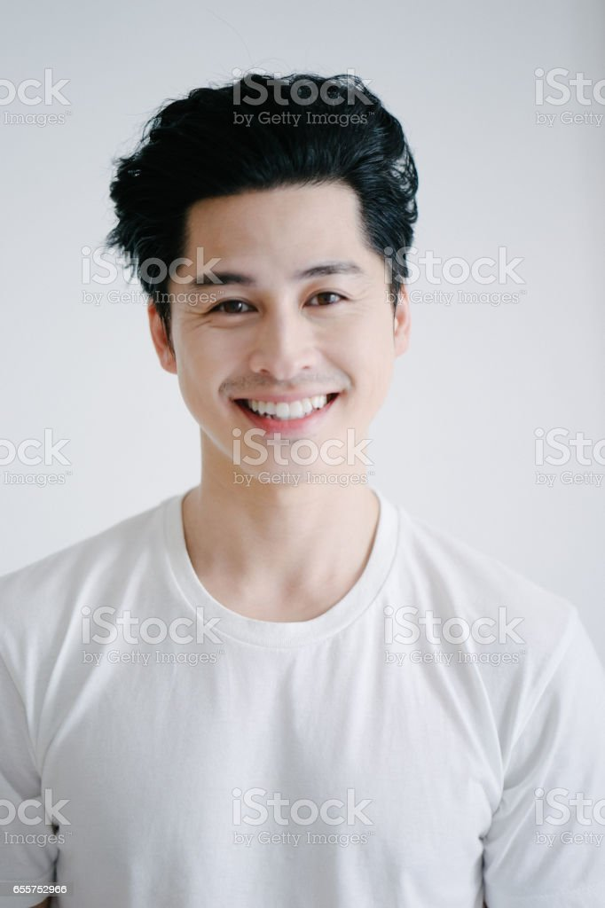 Portrait of asian man smiling, white background stock photo