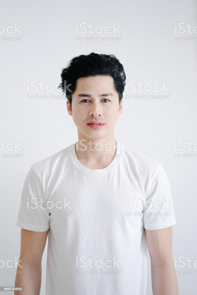 Portrait of asian man, white background stock photo