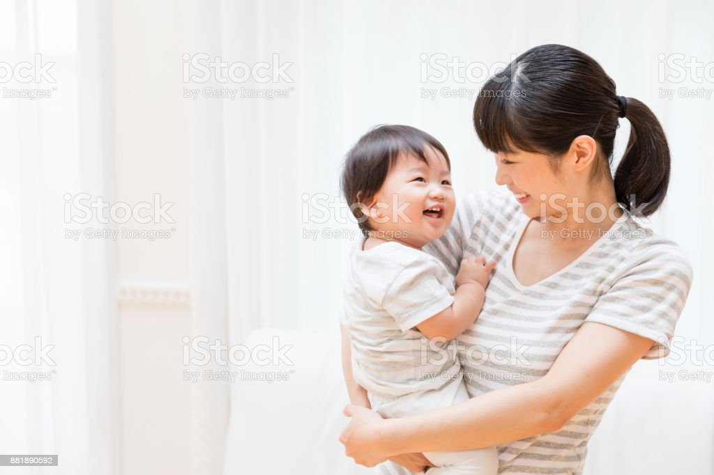 portrait of asian mother and baby lifestyle image stock photo