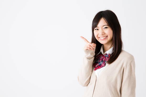 白い背景に分離されたアジア学校の女の子の肖像画 - 制服 ストックフォトと画像