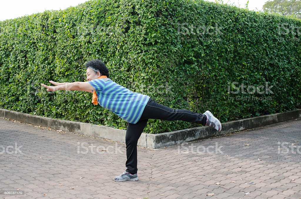 Portrait of Asian Senior Stretching in the park stock photo