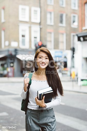 521911045istockphoto Portrait of Asian Student 860794542