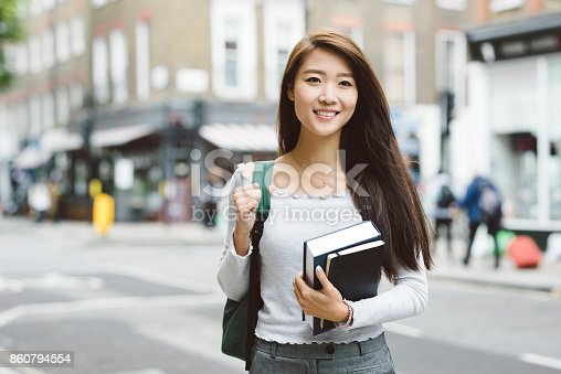 521911045istockphoto Portrait of Asian Student 860794554
