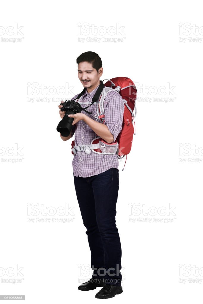 Portrait of asian tourist with backpack and camera - Royalty-free Adult Stock Photo