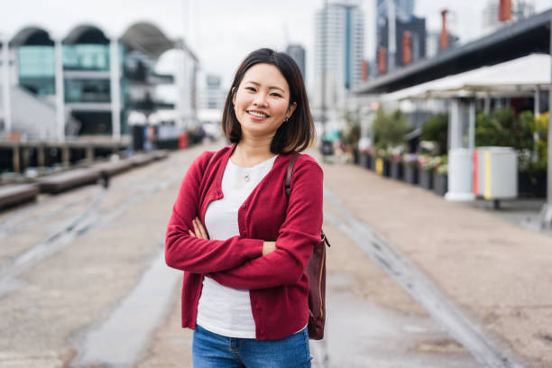 Portrait of Asian woman in city. stock photo