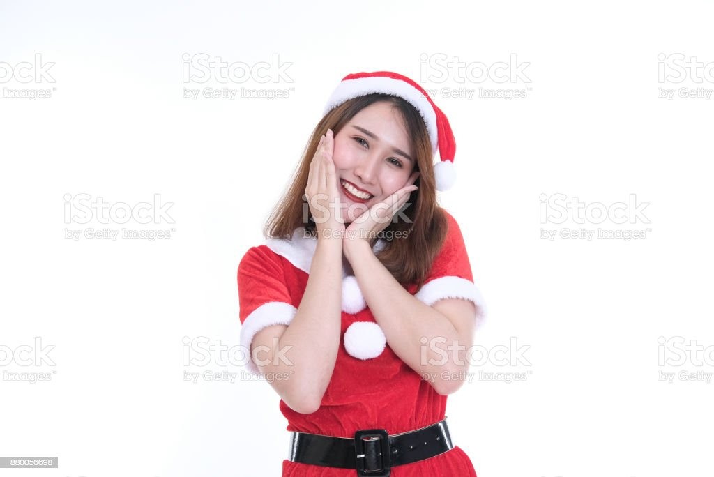 aac5e564cc043 Portrait of asian woman in santa claus dress on white background. christmas  holiday. merry xmas celebration. - Stock image .