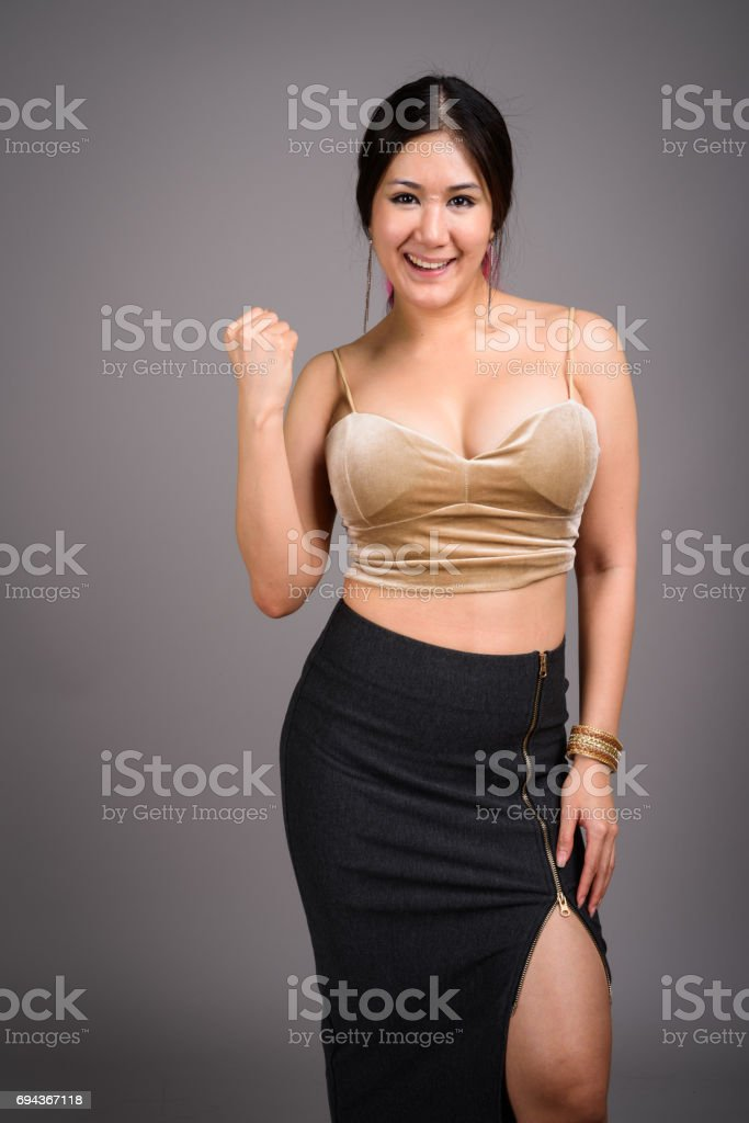 Portrait of Asian woman indoors stock photo