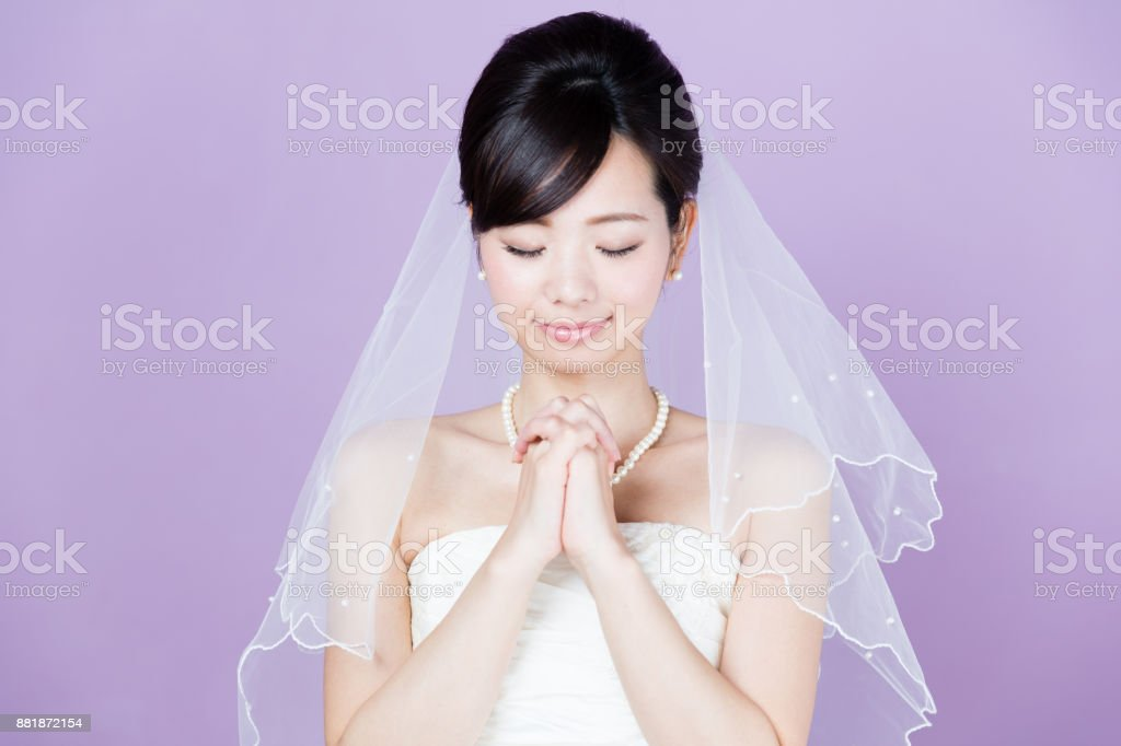 portrait of asian woman wedding image on purple background stock photo