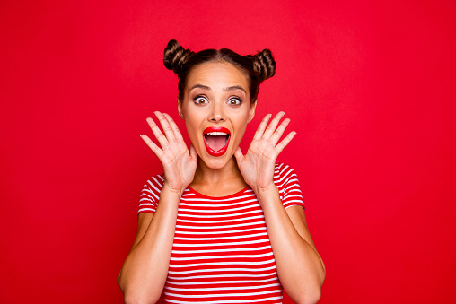 istock WOW! Portrait of astonished surprised girl with wide open mouth eyes gesturing with palms near face isolated on red background 1033719866