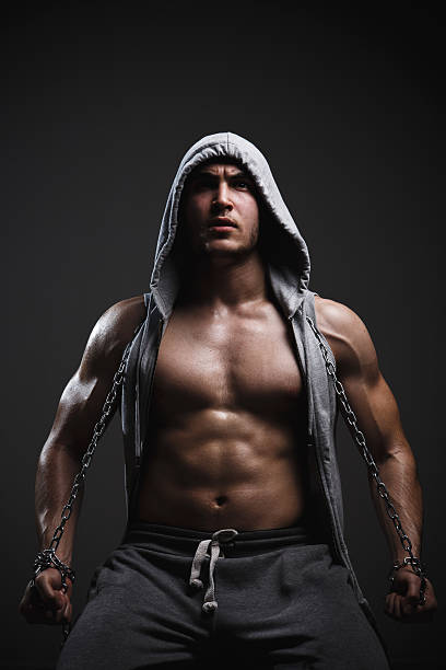 Portrait of athletic man in a hooded jacket stock photo